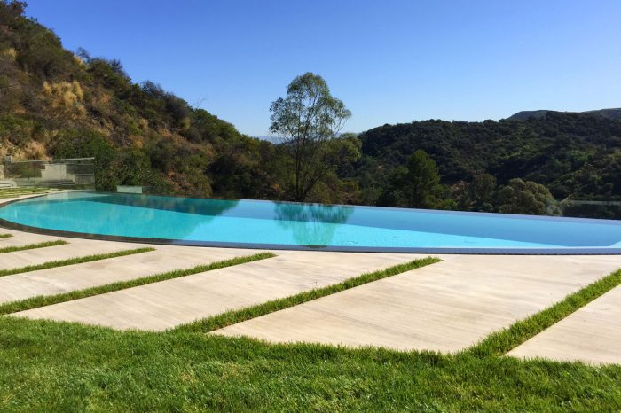 lawn and pool view by coastal aquatic creations at bel air